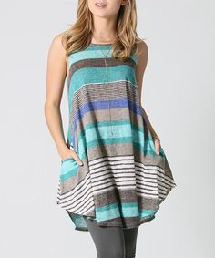 42POPS Blue Stripe Pocket Swing Tunic | zulily  . $15.79 $58.00 size: ( SIZE CHART ) .http://www.zulily.com/p/sizechart/38888907  . S M L XL Product Description:  Offering a great everyday look, this top has an eye-catching pattern and a comfortable swingy cut that falls effortlessly over curves. Convenient side pockets sweeten the deal.      76% polyester / 24% spandex     Hand wash     Made in the USA