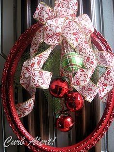 Spray paint a round picture frame, hang ornaments and put on a ribbon and you have a beautiful wreath display! + other ideas. I think this would be clever in orange with two black eyes and a mouth suspended from fishing line so the swivel round on the front porch for Halloweeny! Gourds for autumn, eggs for easter, daisies for spring, hearts, etc.