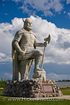 A Noble Viking statue stands on the shores of Lake Winnipeg looking toward the town of Gimli in the Province of Manitoba, Canada, a reminder of the town's historic Icelandic background. Statues, O Canada, Canada Travel, Robin Wright, Bronze, Viking Pictures, Sculpture Metal, Western Canada, Roadside Attractions