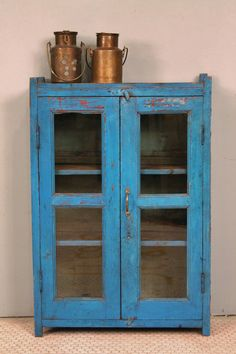 Reserved for Quavin Vintage Distressed Bright Blue Painted Indian Glass Storage Cabinet Curio. $469.00, via Etsy.