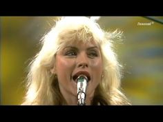 BLONDIE LIVE 1977 - MUSIKLADEN EXTRA Recorded in 1977. Aired 19. Jan. 1978. DEBBIE HARRY backed by CHRIS STEIN, FRANK INFANTE, JIMMY DESTRI, NIGEL HARRISON & CLEM BURKE. 1) X OFFENDER 00:00  2) DETROIT 442 02:41 3) A SHARK IN JETS CLOTHING 5:05 4) IN THE SUN 08:23 5) FAN MAIL 10:47 6) LITTLE GIRL LIES 13:34 7) RIFLE RANGE 15:30 8) CAUTIOUS LIP 18:54 9) CONTACT IN RED SQUARE 23:01  10) KUNG FU GIRLS 24:51 11) GOLDFINGER 26:57
