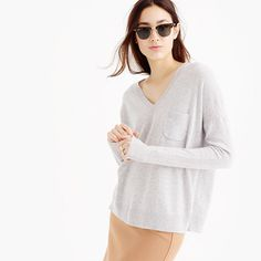 """We work with one of the best Italian mills to create our cashmere—it's famously soft, comes in completely custom colors and, if you treat it with love, it will last forever. This style features a just-right length and rib details, plus a cute little pocket at the front. <ul><li>Relaxed fit.</li><li>Body length: 24 3/4"""".</li><li>Sleeve length: 30 1/2"""".</li><li>Hits slightly below hip.</li><li>Italian cashmere.</li><li>Rib trim at neck, armholes, side seam and hem.</li><li>Hand…"""