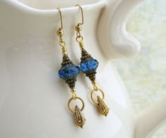 Blue and Gold earrings with turbine Czech glass beads and a little brass drop by ElainaLouiseStudios, $18.00