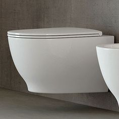 RAK Harmony Wall Hung Toilet with Soft Close Seat The Harmony range from RAK displays a modern design, with bold lines alongside sweeping curves to present a product that can cater to both modern and contemporary bathrooms. This configuration includes a Floating Toilet, Floating Sink, Wall Hung Toilet, Downstairs Toilet, Tiny House Bathroom, Small Bathroom, Family Bathroom, Bathroom Ideas, Rak Display