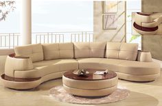 Luxury Beige Sectional Curved Shaped Sofa Design Ideas for Living Room Furniture with Low Style Brown Wood Materials Legs and Modern Leather Seat Cushions complete with the Back Cushions