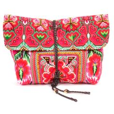 Traditional hand embroidered tribe costume used to create this fold over clutch with zipper and double snap closure. Each bag is one of a kind. Email sales@jadetribe.com for images of exact bags in st