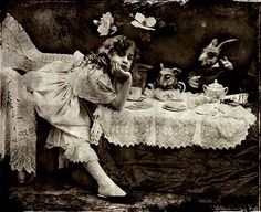 Alice has a tea party.