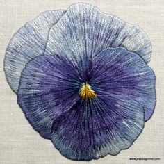 Needle painted violet with a single strand of DMC floss. After a picture I took of the violets on my balcony. I teach this as a five day embroidery class http://www.jessicagrimm.com/kurse-cursus-course.html.