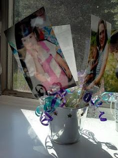 So cute! - Ill put pictures of me throughout the years in the flower arrangements kind of like this