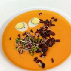 Salmorejo is a creamy cold soup made with bread and tomatoes. It's served  served with Serrano ham and hard-boiled eggs. This one is from Sevruga in Coria del Rio, AL, Spain