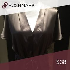 Calvin Klein grey silk blouse Long silk blouse in dust color with short sleeves and tie waist. Beautiful. Calvin Klein Tops Blouses