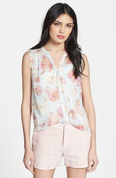 Love the floral print on this sleeveless silk blouse.
