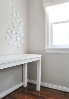 might have to DIY a desk for our new house (my office will be in the family room) and I love this one. so simple & looks great against gray walls (which will have)