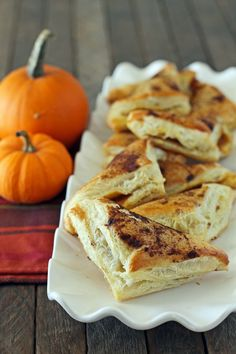 These Pumpkin Pie Pastry Pockets are the perfect way to get the decadent flavors of your favorite pie for just 132 calories or 4 Weight Watchers points! www.emilybites.com