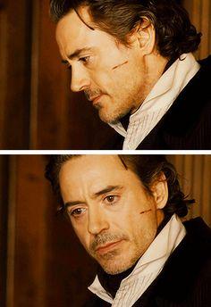 He has the saddest eyes...  (Robert Downey Jr. as Sherlock Holmes, learning of Irene's death...)