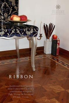 The RIBBON hardwood floor border inlay. http://www.pavexparquet.com/en/borders_geometrica/GB171-hardwood-floor-border-inlay-ribbon.htm