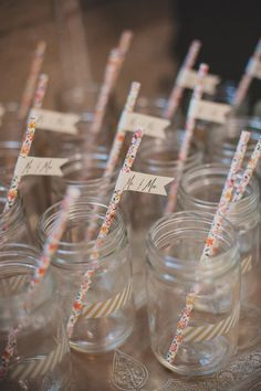 jars with floral straws + banners, photo by Next to Me Studios http://ruffledblog.com/san-diego-loft-wedding #drinks #weddingideas #wedding