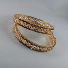 Buy Floral Design Gold Tone Bangle Set at Haveaclick.com