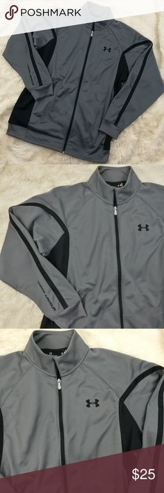 "Mens Under Armour Zip Up Track Jacket Large Men's zip up Under Armour track jacket. Black and charcoal gray. Small snag on right sleeve as photographed. Smudge on back logo below neck. Size large.   Pit to Pit 24"" Top of shoulder to bottom hem 30"" Under Armour Jackets & Coats"