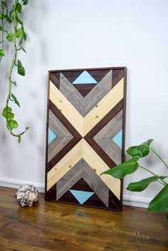 Perfect focal point for your wall or for a space that needs something special and unique to enliven it. Each piece is made exclusively with locally sourced Black Walnut, White Oak, and Douglas Fir. Th