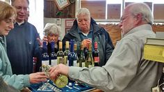 Decanter's proprietor, Eric Stein, pours a selection of kosher for Passover wine for CJC members.