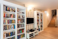 adorable-ebay-bookshelves-with-wall-lamps-wooden-stairs-and-wooden-floor-also-hanging-flat-tv.jpg (849×566)