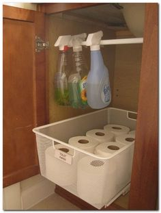 Use a tension rod to get bottles off the cabinet floor, making room for other things. I love the pull out box but the tension rod doesn't hold more than the 3 bottles shown. Organisation Hacks, Organizing Hacks, Organizing Your Home, Bathroom Organization, Storage Organization, Cleaning Hacks, Bathroom Hacks, Bathroom Storage, Bathroom Cabinets