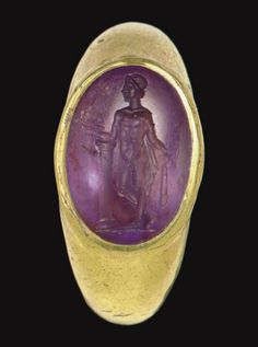 A ROMAN GOLD AND AMETHYST FINGER RING  CIRCA 2ND CENTURY A.D.