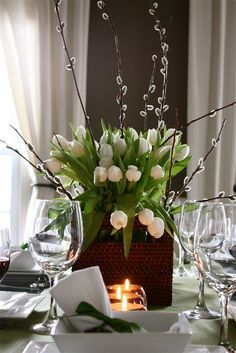 This flower arrangement makes my heart flutter.....what is more beautiful than sitting on your dinning table looking like this for a meal ?