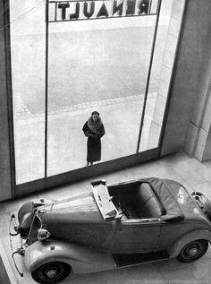 Renault showroom - Champs Elysées,      Paris, France, 1934. Photo by Robert Doisneau.