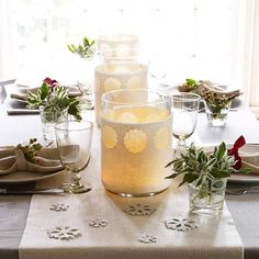 Use white felt to make this simple white holiday table. More Christmas centerpieces: http://www.bhg.com/christmas/indoor-decorating/simple-christmas-centerpieces/?socsrc=bhgpin110212whiteholidaycenterpiece#page=23