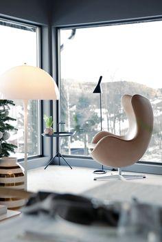 Modernist corner with Arne Jacobsen's Egg Chair and AJ Floor Lamp; and Panthella Floor Lamp by Verner Panton.