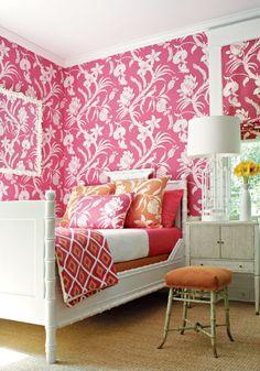thibault pink wallpaper, orange and pink bedding, white bamboo bed