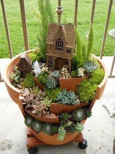 Awesome clay pot...mini fairy garden!