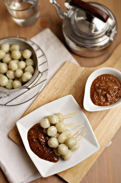 CILOK (steamed chewy balls made from tapioca starch--in some parts of Indonesia it is grilled. the taste is savory, and usually served with spicy peanut paste (saus kacang) and soy sauce (kecap).
