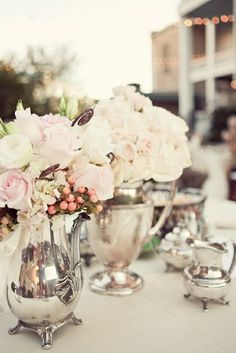Cool idea to use vintage teapots and creamers as vase.