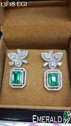Adorn emerald earring and look elegant.