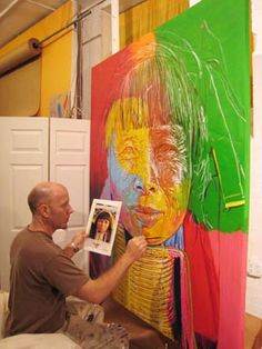 Stephen Bennett painting woman of the Karen Tribe from Northern Thailand. He only uses photos that hes personally taken as visual reference.