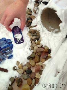"Snowy sensory tub: Shaving foam & some natural elements like branches & pebbles - from One Perfect Day ("",)"