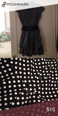 Polka dot dress Polka dot button-down dress (in the front and doesn't go the whole way down), only worn on a few occasions, comes with a belt (as pictured) Dresses Midi