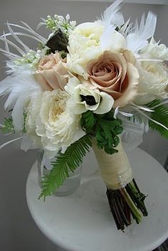 Love those mocha colored roses. pretty  for bridal bouquet...i wan t feathers! :)