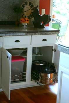 No more digging through your cabinets! Organize pots & pans with these pull out cabinet baskets.