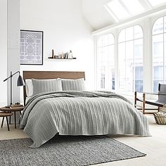 Soft and subtle hues of neutral grace the face of the luxurious soft Kenneth Cole Granite Coverlet. This quilted coverlet is crafted from 100% cotton for resplendent comfort and is designed to incorporate simple yet sumptuous style into your bedroom.