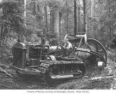 Logger with tractor and yarding arch, Simpson Logging Company camp no. 5, ca. 1940
