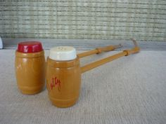 Vintage Salt and Pepper Shakers with Wood for grilling.