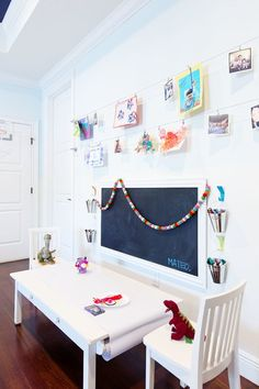 These 10 fantastic playrooms you need to see will leave you feeling inspired to bring some magic to your kids play spaces. Bold color, cute book and toy storage, play kitchens, decals and wallpaper. even a feature fish. Give your little ones a little wh Modern Playroom, Playroom Art, Playroom Design, Playroom Ideas, Playroom Colors, Bonus Room Playroom, Little Girls Playroom, Playroom Wallpaper, Playroom Table