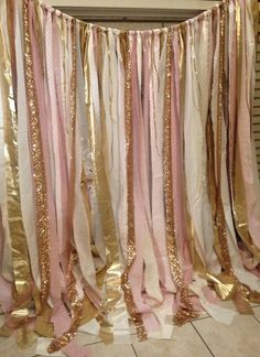 Gold sparkle sequin mixed with shades of Pink. Made with various fabric strips, and gold sequin Torn and rag tied - edges are meant to fray.