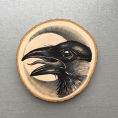 Wood slice / plank with original drawing of a crow door Inkspirednl
