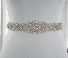 This stunning vintage inspired bridal sash is embellished with pearls and high quality glass crystals. The embellishment is 2 wide x length is