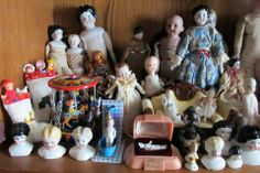 some of the small antique and vintage dolls...china heads, all bisque, celluloid, bisque head, frozen Charlottes, and a tin merry go round!